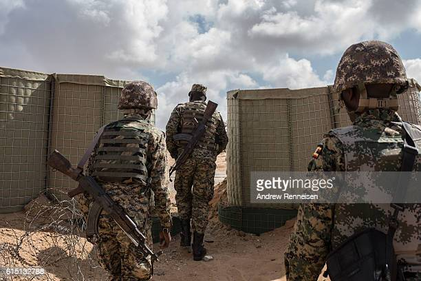 Soldiers in the 17th Battle Group of the Uganda People's Defense Force serving in the African Union Mission in Somalia exit AMISOM's Forward...