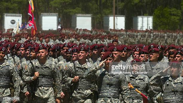 Soldiers in the 82nd Airborne Division pass in review in front of President George W. Bush during the annual All-American Week Celebration at Fort...