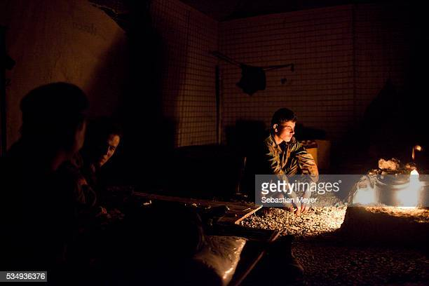Soldiers in the Afghan National Army who share COP JFM with Bravo Troop make tea before going out on a pre-dawn partnered mission. Bravo...