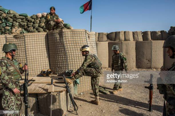 Soldiers in the Afghan National Army's 6th Kandak prepare to go on a joint patrol with United States forces near Command Outpost AzimJanKariz on...