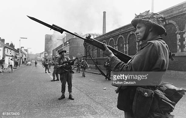 Soldiers in the Falls Street area in Belfast after fire at a mill which is still blazing in the background   Location Fall Street area Belfast...
