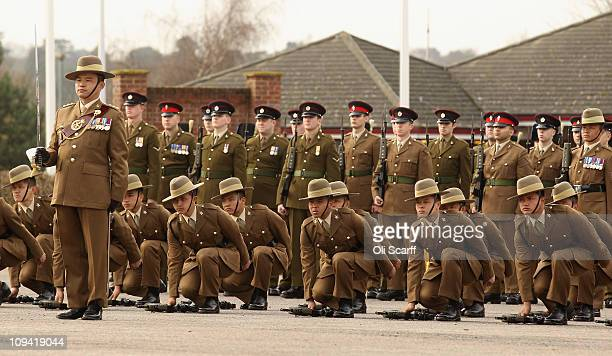 Soldiers in the Queen's Gurkha Engineers place their guns on the ground in the parade square of Invicta Park Barracks on February 24 2011 in...