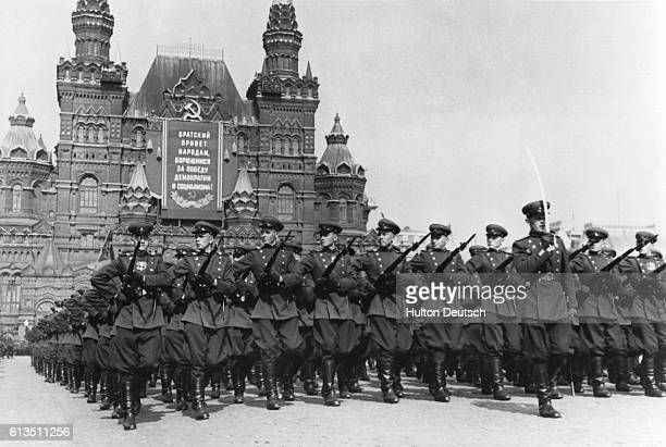 Soldiers in the Red Army march in a May Day parade outside of the State Historical Museum Moscow