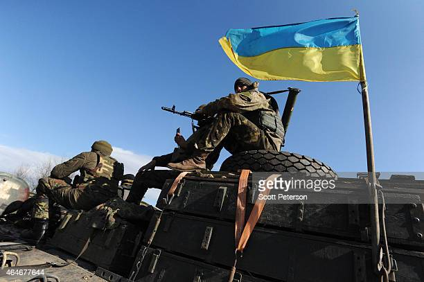 Soldiers in the Ukrainian Army withdraw 15, 100 mm caliber artillery guns in Soledar, eastern Ukraine, on February 27, 2015. In accordance with a...