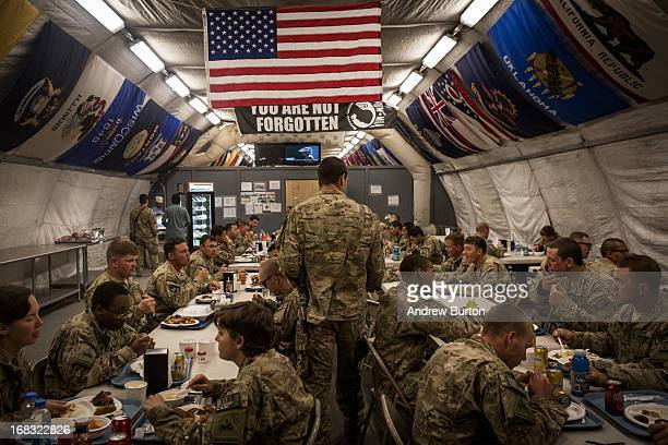 Soldiers in the US Army eat dinner at Forward Operating Base Azzizulah on March 18 2013 in Kandahar Province Maiwand District Afghanistan The United...