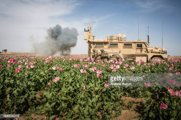 Soldiers in the US Army's 1st Battalion 36th Infantry Regiment blow up an improvised explosive device found during a patrol near Command Outpost...