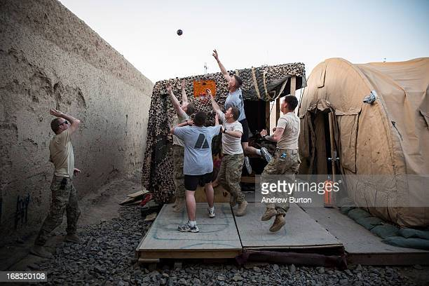Soldiers in the US Army's 1st Battalion 36th Infantry Regiment Bravo Company entertain themselves by playing basketball at Command Outpost...