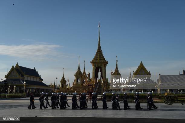 Soldiers in uniform march past the crematorium built for the late Thai King Bhumibol Adulyadej before the final dress rehearsal for his funeral in...