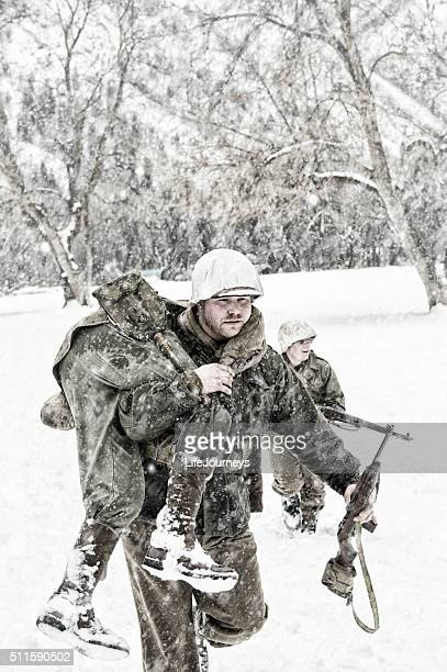 Soldiers in WWII Evacuating A Wounded Team Member