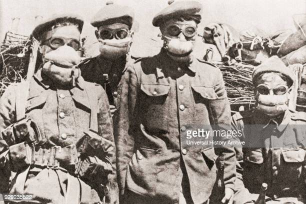 Soldiers in Ypres during World War One using early gas masks, which were pads of cotton wool soaked in a solution of common washing soda. From The...