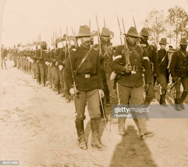 Soldiers, including African Americans, marching, Spanish-American War.