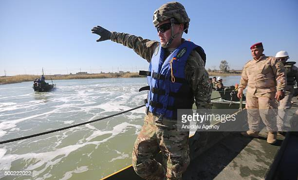 US soldiers inform Iraqi army engineers about how to use portable floating bridges in Baghdad Iraq on December 6 2015 American military attaches in...