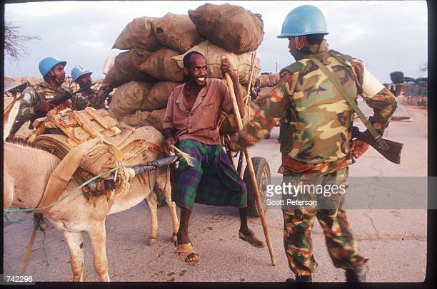 UN soldiers inspect a man with a mule at a checkpoint January 23 1994 in Mogadishu Somalia The UN peacekeeping mission aimed at ensuring food...