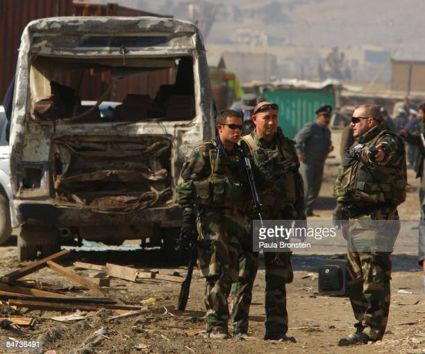 Soldiers inspect the scene outside the Bureau of Prisons justice building after Taliban militants targeted three government buildings in the Afghan...