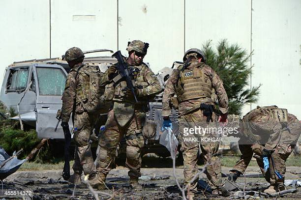 US soldiers inspect the site of a suicide attack in the Afghan capital Kabul on September 16 2014 A Taliban suicide bomber rammed an explosivesladen...