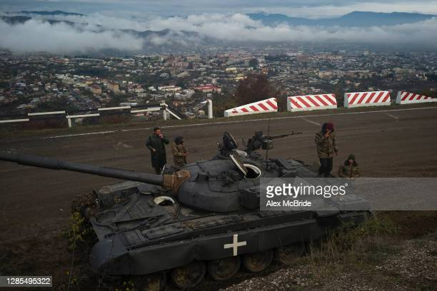 Soldiers keep guard by the side of the road where the final days of battle had occurred between Armenian forces and approaching Azeri forces several...