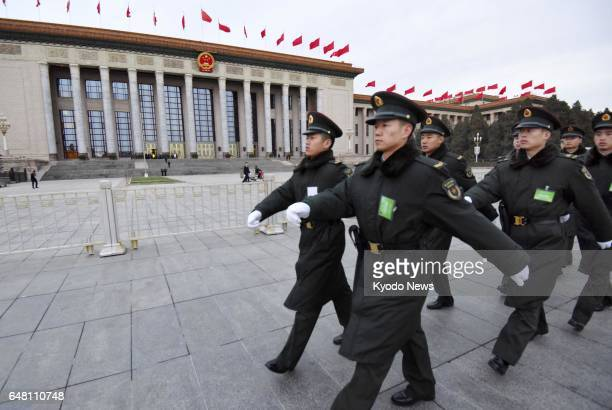Soldiers keep guard on March 5 around Beijing's Great Hall of the People where the National People's Congress started ==Kyodo