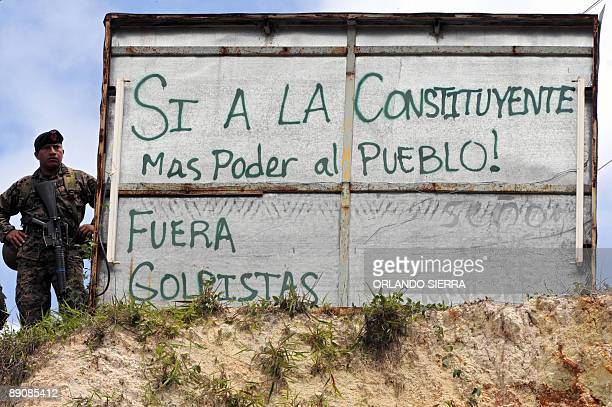 A soldiers keeps watch as supporters of ousted Honduran President Manuel Zelaya block the InterAmerican highway in the hamlet of El Durazno 10 km...
