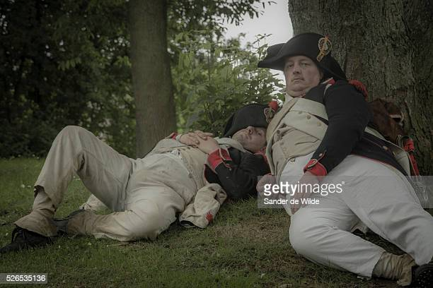 Soldiers lay down resting in a parc of Waterloo The Battle of Waterloo was reenacted this weekend 22 23 June 2013 in Waterloo Belgium by a few...