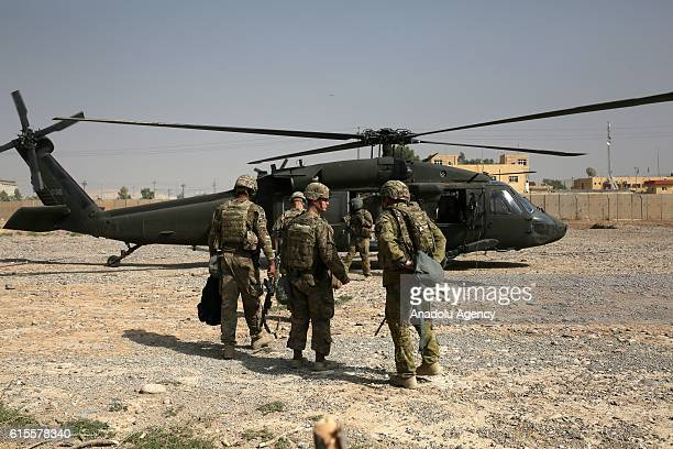 US soldiers leave Nineveh Joint Operations Command Headquarters with helicopters to go to AlKayyara district and around Mosul in Nineveh Iraq on...