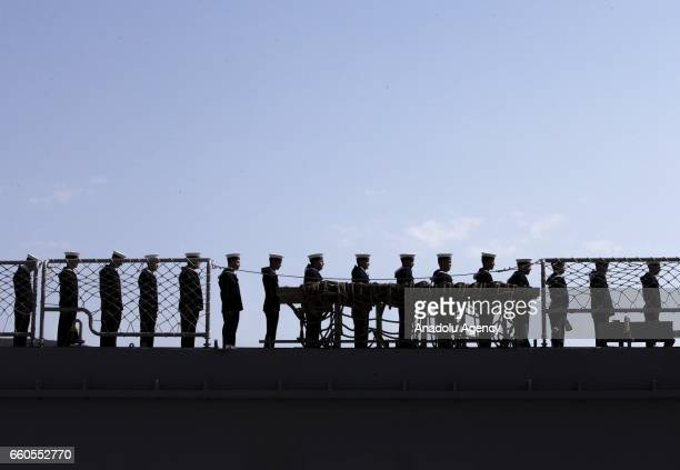 Soldiers leave the Turkish Navy frigate TCG ERTUGRUL which was built at Wisconsin State and got veteran title after it was used on Cyprus Peace...