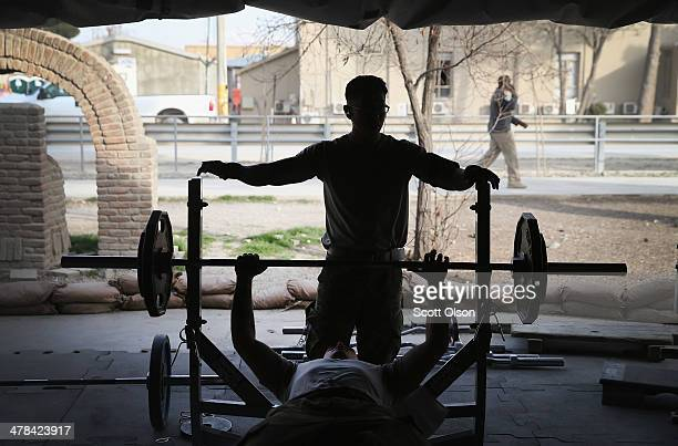 Soldiers lift weights at one of the gyms on Bagram Airfield on March 13, 2014 near Bagram, Afghanistan. Located about 35 miles from Kabul, Bagram...