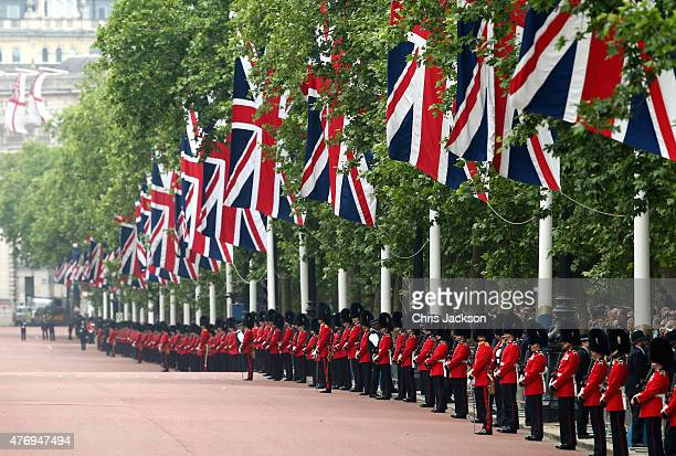 Soldiers line up on The Mall ahead of the Trooping The Colour ceremony on June 13 2015 in London England The ceremony is Queen Elizabeth II's annual...