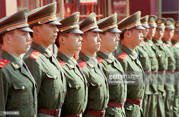 Soldiers lining up in one row at forbidden city in beijing