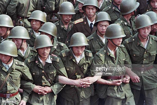 Soldiers Linking Arms at Tiananmen Square