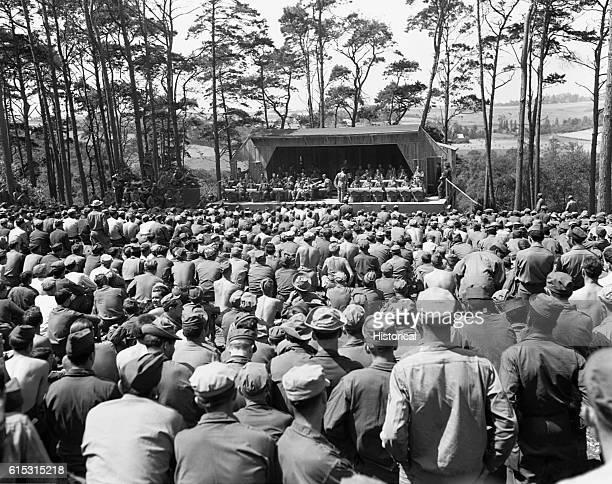 US soldiers listen to a Saturday afternoon jam session by Glenn Miller's Band at Camp Herbert Tareyton near Le Havre France