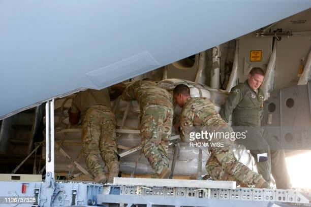 US soldiers load a C17 cargo plane with food water and medicine for a humanitarian mission to Venezuela at Homestead Air Force Base in Homestead...