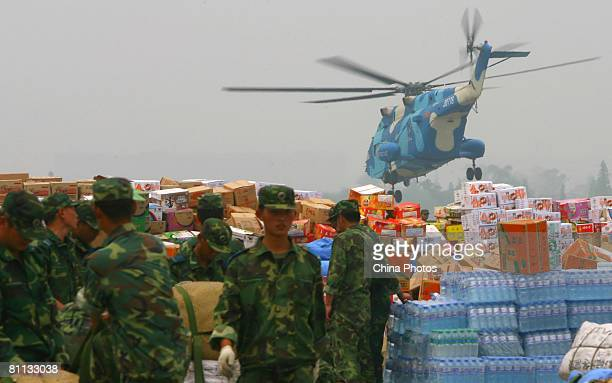 Soldiers load helicopters with emergency relief goods to be sent to earthquakedamaged Wenchuan County from the Taipingsi Airport on May 17 2008 in...