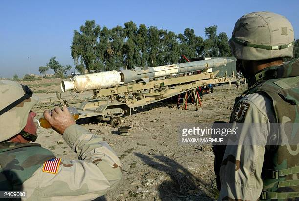 US soldiers look at a Sovietmade SA2 surfacetoair missile being prepared for destruction as part of explosive ordnance disposal operations by US...