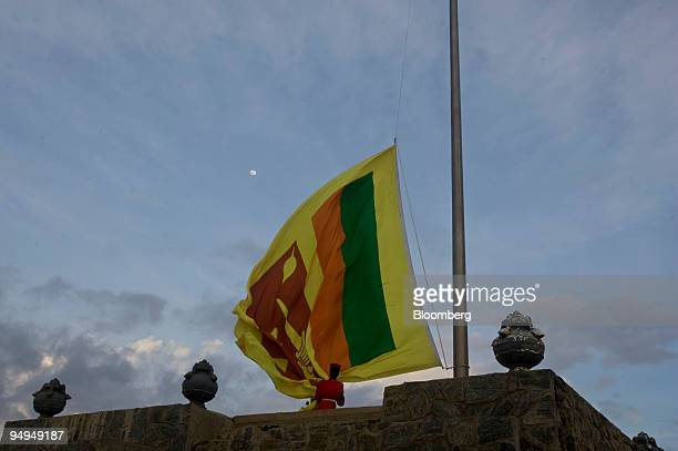 Soldiers lower a Sri Lankan flag in Colombo Sri Lanka on Thursday June 4 2009 Sri Lanka's navy said it seized a ship that entered the country's...