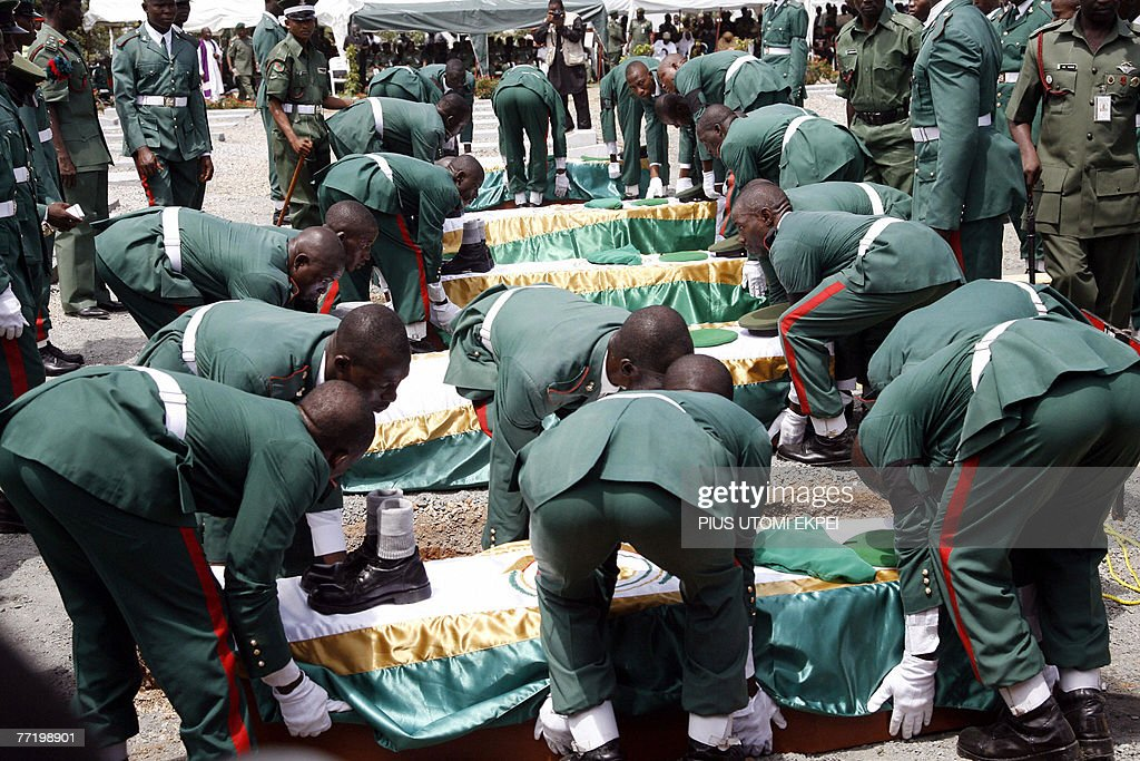 Soldiers lower into the grave in Abuja, : News Photo