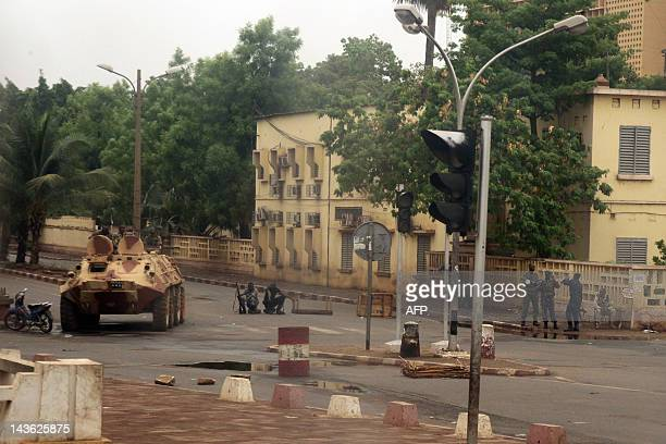Soldiers loyal to Captain Amadou Haya Sanogo sit on an armoured vehicle and stand guard at the Patrice Lumouda roundabout 500m from Mali's radio...