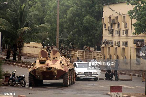 Soldiers loyal to Captain Amadou Haya Sanogo sit on an armoured vehicle at the Patrice Lumouda roundabout 500m from Mali's radio station ORTM in...