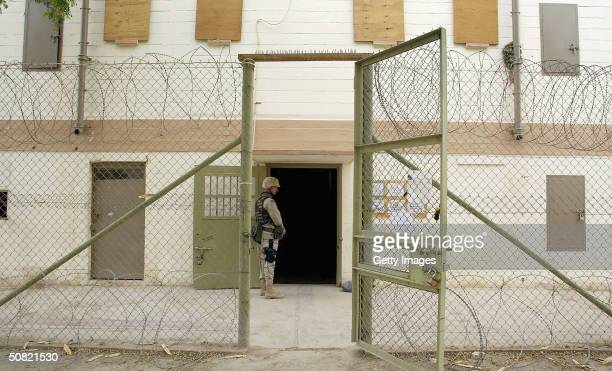 S soldiers maintain security at the Abu Ghraib prison May 10 2004 in Abu Ghraib Iraq Allegations of abuse at the prison notorious under the Saddam...