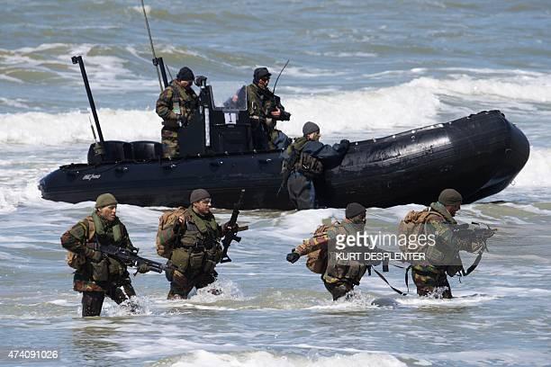 Soldiers make a beach landing during joint BelginDutch military exercises at Lombardsijde camp in Nieuwpoort on May 20 2015 AFP PHOTO / BELGA / KURT...
