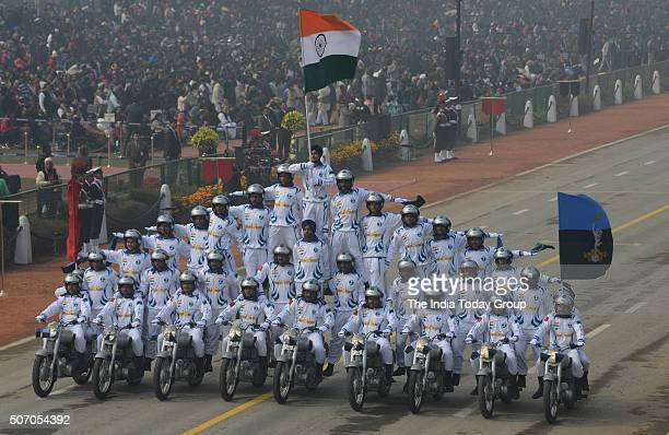Soldiers make formations on motorcycles as they roll down Rajpath during the Republic Day parade in New Delhi