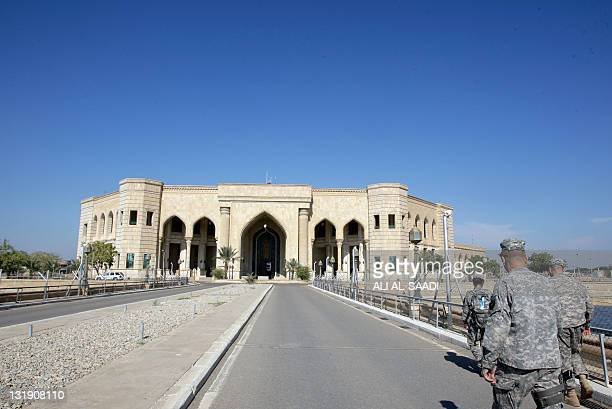 US soldiers make their way on November 7 to the AlFaw palace formerly belonging to executed Iraqi leader Saddam Hussein and located in what is now...