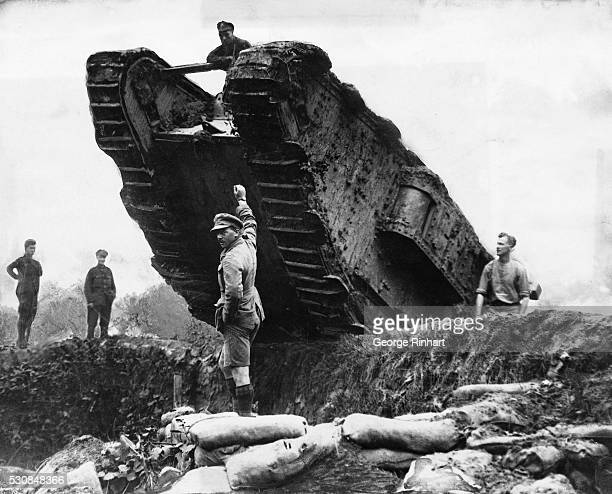 Soldiers maneuver a tank or 'landship' over a trench during the Battle of Cambrai just west of the French town | Location West of Cambrai France