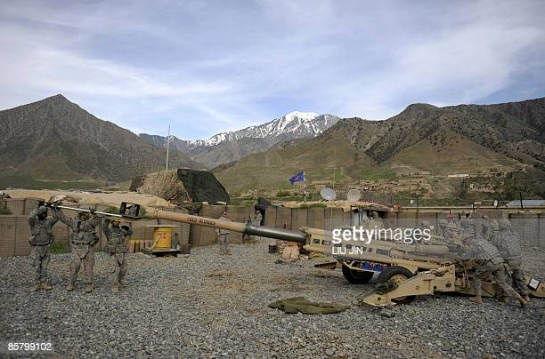 Soldiers manouver a M-777 howitzer after firong practice shots at ISAF's Camp Bastick in Naray, in Afghanistan's eastern Kunar province on April 4,...