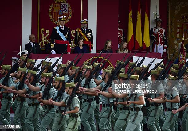 Soldiers march as King Felipe VI of Spain his wife Queen Letizia and their daughters Princess Leonor and Princess Sofia attend the Spanish National...