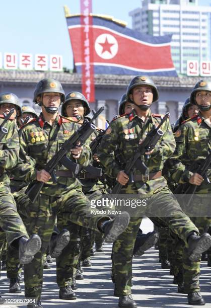 Soldiers march during a military parade at Kim Il Sung Square in Pyongyang on Sept. 9 to mark the 70th anniversary of the country's founding. ==Kyodo