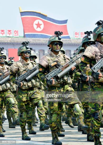 Soldiers march during a military parade at Kim Il Sung Square in Pyongyang on April 15 as North Korea marked the 105th anniversary of its founding...