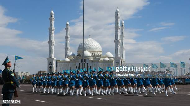 Soldiers march during a military parade marking the 25th Foundation Anniversary of the Kazakhstan Armed Forces called Defender of the Fatherland Day...