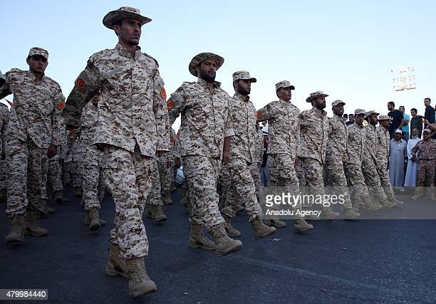 Soldiers march during a military parade within a ceremony marks fourth anniversary of revolt which ousted dictator Muammar Gaddafi fearful for the...