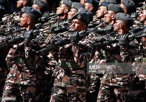 soldiers march during a parade - sri lanka commando stock photos and pictures