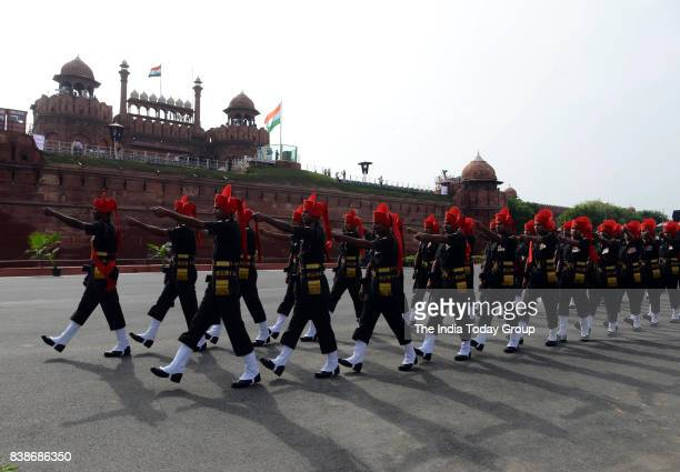 Soldiers march during the fulldress rehearsal for the 71st Independence Day celebrations at the Red Fort in New Delhi